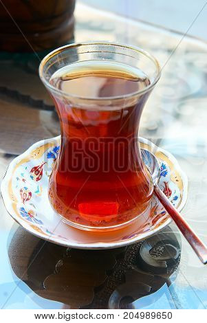 Turkish tea on a plate with spoon
