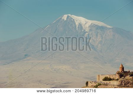 Khor Virap Monastery. Mount Ararat on background. Exploring Armenia. Armenian architecture. Tourism and travel concept. Mountain landscape. Religious landmark. Tourist attraction. Copy space for text