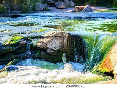 A beautiful Colorful view of Waterfall on Kamenka river, Tokovskoe settlement, Apostolove Raion, Dnipropetrovsk Oblast, Ukraine. Artistic style post processed photo.