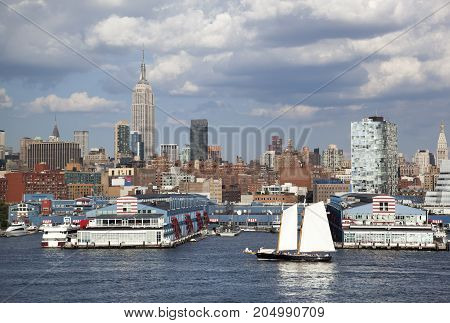 The ship passing by piers of Manhattan Midtown (New York City).