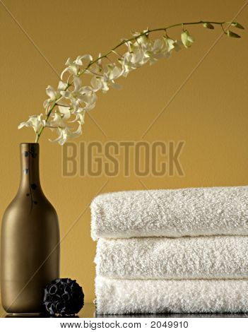 White Spa Towels And Vase With Flowers