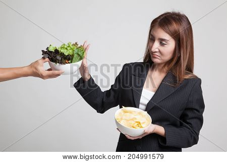 Young Asian Woman With Potato Chips Say No To Salad.