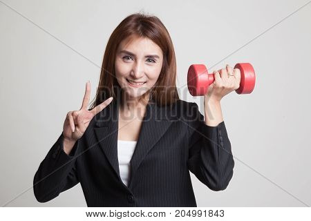 Healthy Asian Business Woman Show Victory Sign With Dumbbells.