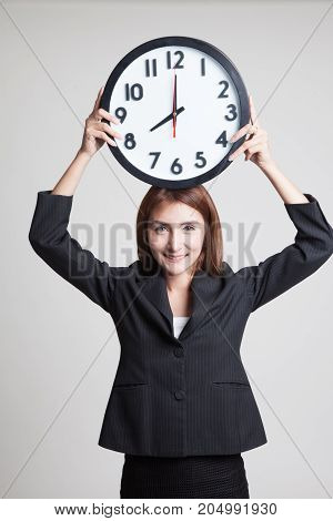 Young Asian Business Woman With A Clock.