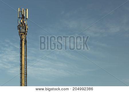 Cellular base station on a blue sky background