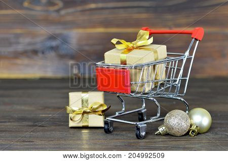 Christmas shopping cart with gift boxes and Christmas decoration