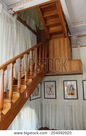 Wooden Staircase To The Second Floor.