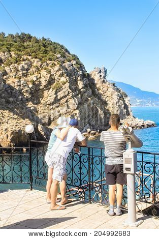 Yalta, Crimea - 11 July, People look at the sea, 11 July, 2017. Small Castle Lastochkino Nest and its surroundings.