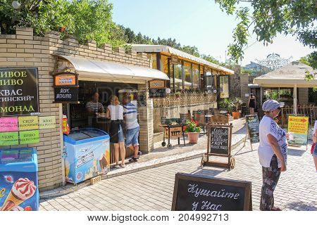 Yalta, Crimea - 11 July, Pavilions of street trading, 11 July, 2017. Small Castle Lastochkino Nest and its surroundings.