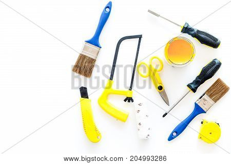 house renovation with implements set for building, painting and repair on white table background top view mockup