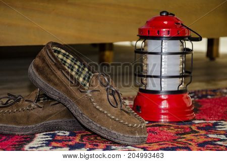 Slippers and lantern in a glamping tent in New York.