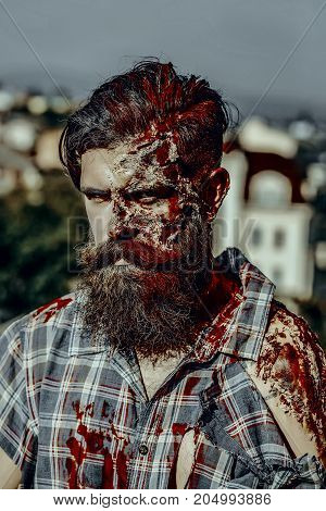 Halloween Zombie In Torn Shirt Outdoors