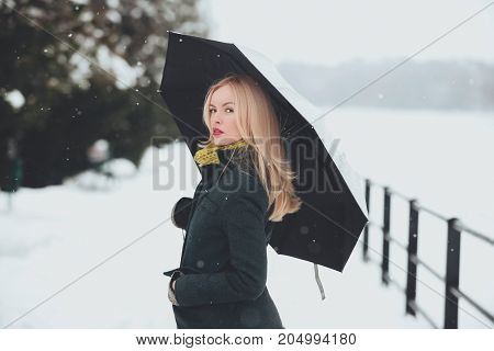 Woman With Long Blond Hair On White Snow Landscape