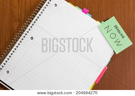 Deadline Now; White Blank Documents With Small Message Card.