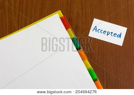 Accepted; White Blank Documents With Small Message Card.