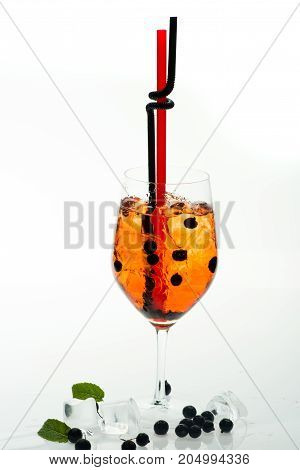 Drinking Straw In Cocktail Glass At Bar.