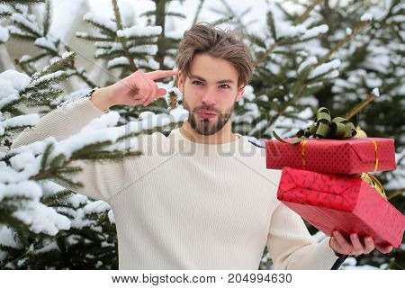 Man Pointing Finger With Red Boxes In Snow Wood