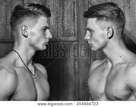 Twins With Muscular Chest