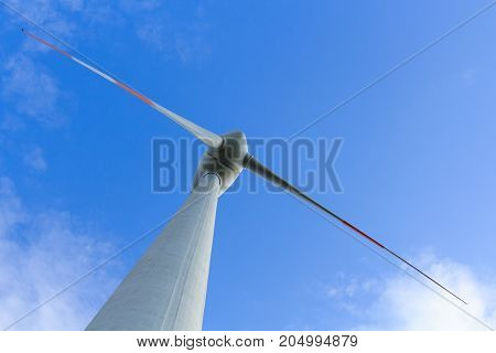 View of wind turbine producing alternative energy
