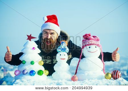 Santa Man Giving Thumbs Up Hands With Snowy Sculptures