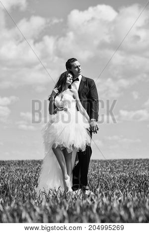 Wedding Couple On Green Grass And Blue Sky