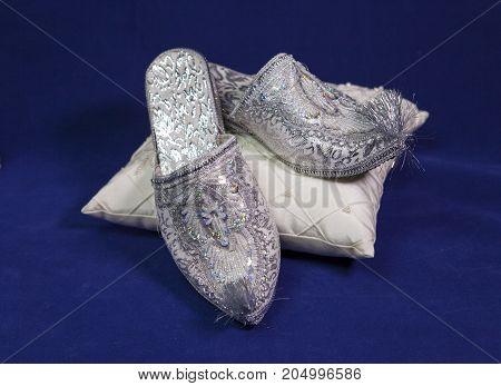 east style bride wedding shoes on a blue velvet