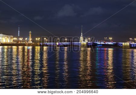Night view of the University embankment of St. Petersburg through the Neva River- Peter and Paul fortress Palace bridge Vasilievsky island
