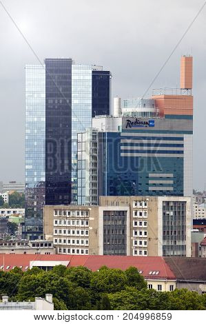 TALLINN ESTONIA- JUNE 17: View of the modern high rise buildings on border with an old part of the city on June 17 2012 in Tallinn Estonia