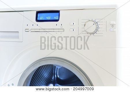 The washing machine - a close up of the display and a choice of programs