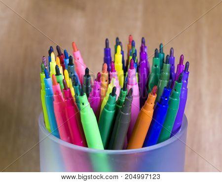 Color felt tip pens still life on a wood background