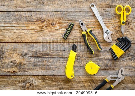 set of tools for build and repair house on wooden desk background top view mock-up
