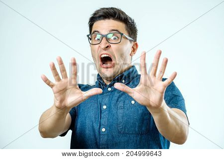 Man With Scared Expression On His Face Making Frightened Gesture With His Palms