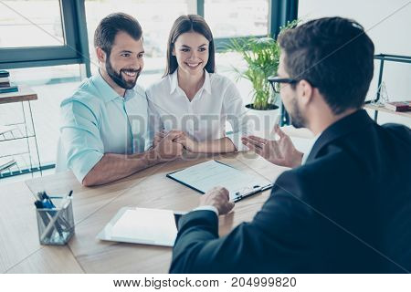 Business Meeting. Happy Couple Is Buying New House, Young Bearded Brunet Lawyer In A Formal Wear Is