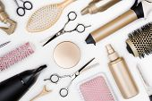 Hairdressing tools and various hairbrushes on white background top view poster