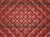 Red Alligator skin with stitched rectangles. Useful as texture or background poster
