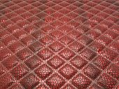 Red Alligator skin with stitched rectangles. Useful as background poster