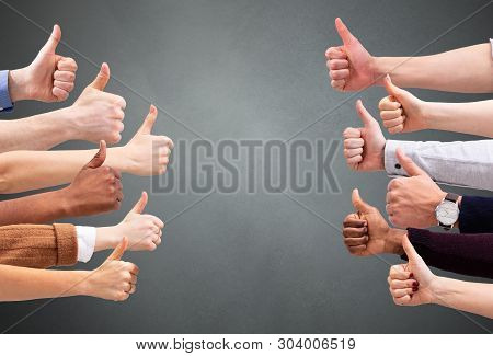People Hand Showing Thumb Up Sign Against Green Backdrop