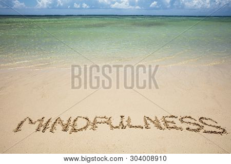 An Overhead View Of Mindfulness Written Text On Sand Near The Sea At Beach
