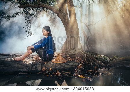Sad Asian Woman Sitting Under The Tree In The Park ,she Passed The Story Lot Worse, Sad Woman