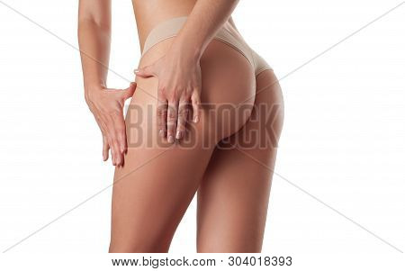 Slim Fit Woman Body. Perfect Female Buttocks And Hips Without Cellulite. Skin Care And Anti Cellulit