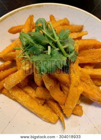 Sweet potato fries with coriander leaves