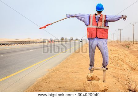 Mannequin of a worker used at road construction sites in Oman