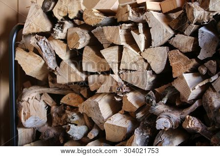 Split Fire Wood. Dried, Split and Stacked Firewood. Old Dried Dead Trees cut up and split in to pieces for future fires and wood burning stoves and fireplaces.