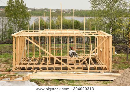 Construction Home Framing Against Blue Sky.wood Frame Residential Building Under Construction.buildi
