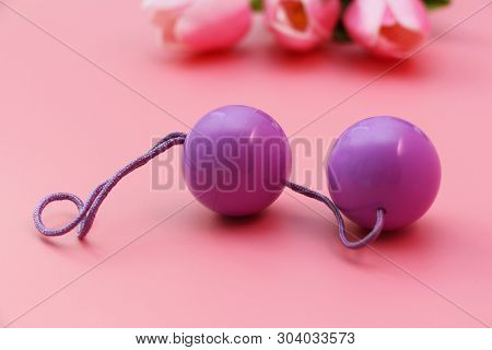 Pink Vaginal Balls On A Pink Background. Double Vaginal Balls. Womans Health. Strengthening The Inti