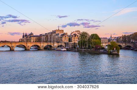 Paris / France - April 04 2019: The Oldest Bridge ( Pont Neuf ) Across Seine River And Historic Buil