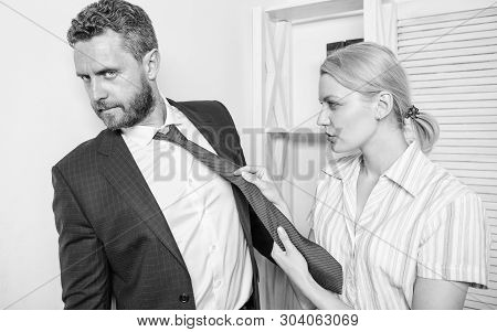 Office And Sexual Behavior. Woman Hold Mans Necktie. Girl Seduce Colleague. Sexual Harassment At Wor
