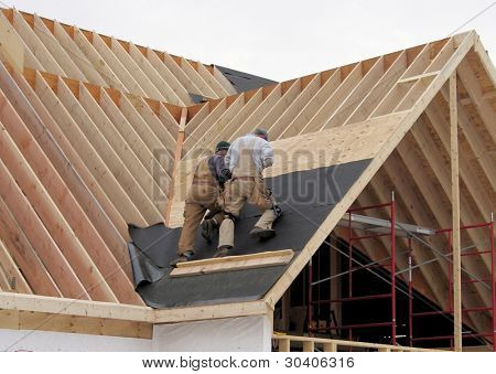 Roofing a house