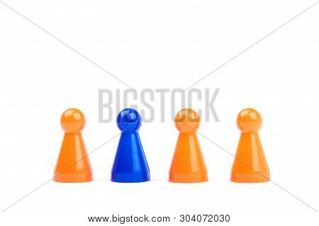 A Series Of Orange Game Pieces And One Different And Exceptional Blue Figure As Leader Or Boss - Iso