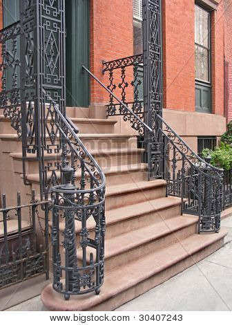 Entrance to Greenwich Village, NYC townhouse with ornate wrought iron railings